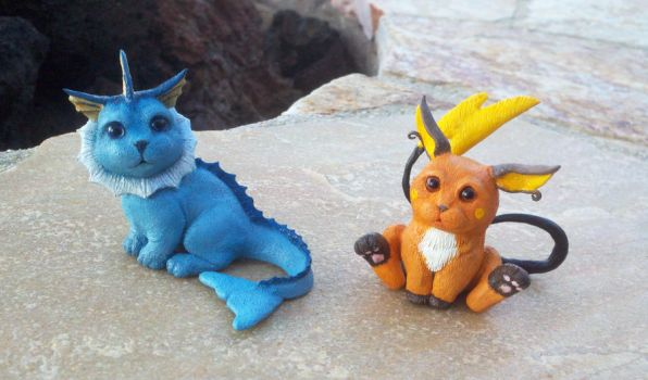 Vaporeon and Raichu Sculptures by IllusionTree