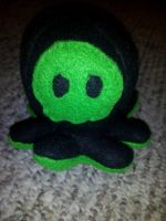 black and green Punisher octopus by TheJadedRaven