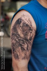 Amazing Lion Tattoo by Sunny Bhanushali at Aliens by Javagreeen