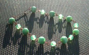 Green and Copper Bracelet by zaphod-beeblebroxie