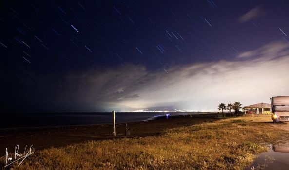 Star trails at the beach by eMyDeA