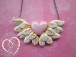Winged heart pendant by ilikeshiniesfakery