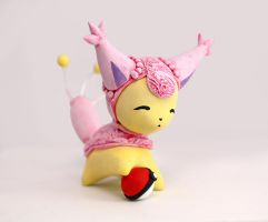 Skitty with a Pokeball figurine