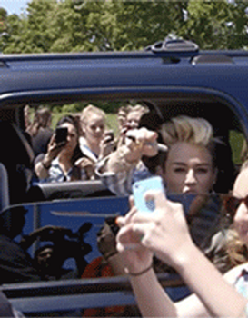 Selfie fail GIF - Miley Cyrus and Fan by EliasPotter