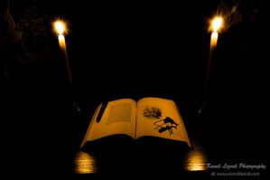 Old book and candles by vertiser