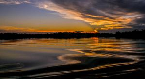 Sunset over Rio Negro by theyoungriver