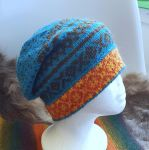 Slouchy turquoise hat by KnitLizzy