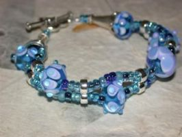 Aqua and Periwinkle Lampwork by tiannei