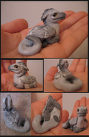 Feather-winged Gray Dragon by tallydragon