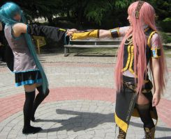 Luka and Miku cosplay by AsleepPanther