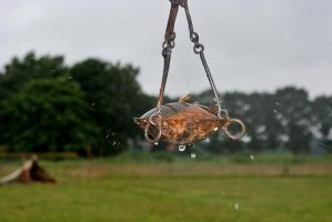 Oil lamp in the rain by Dewfooter