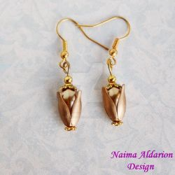 Golden egg earrings by NaimaAldarion
