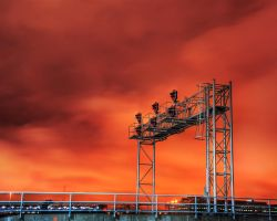 Train signal at sunset by spudart