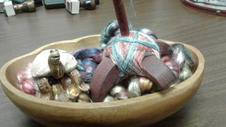 Spinning mulberry silk by Elizabethjunean