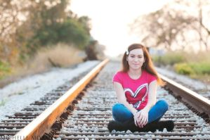 Happy on the train tracks by MichelleMorales