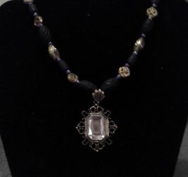 Blue and gold steampunk necklace by BlackUnicornWood