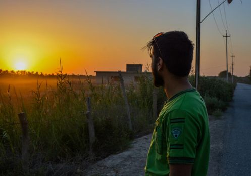 me looking to the sun set by mudhaffr