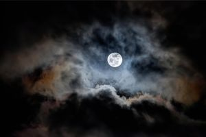 A Full Moon Rising Over Clouds Like Mountains by AugenStudios