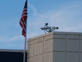 Security Cameras, cloudy sky and American flag by caspercrafts