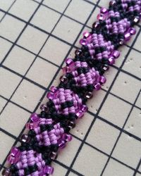 Black and Pink Infinity Bracelet by silhouettes-spirits