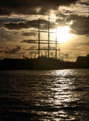 Sailing cruiser against the light ( new edit ) by UdoChristmann