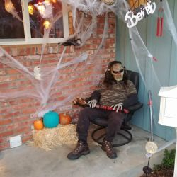 Son-in-law greeting trick-or-treaters by lestnill