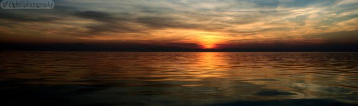 Panorama of a dark sunset by V-Light