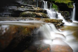 The flow of water over rock by waznitch