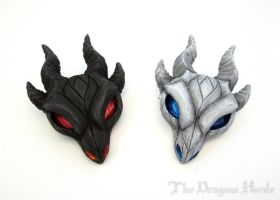 Fire and Ice Dragon Skulls by DragonCid