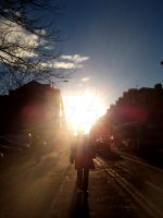 MAN WALKING DOWN BYRES RD by jmcglynn