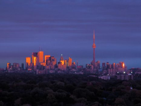 Sunset reflecting off of Toronto by KMourzenko