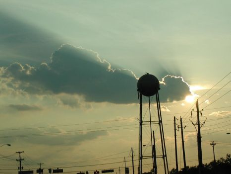 Water tower at dusk by darkwolf777