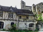 St Cirq Lapopie 08 - medieval houses and church by HermitCrabStock