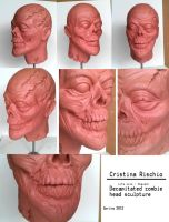 Decapitated zombie head sculpture by Riskyo