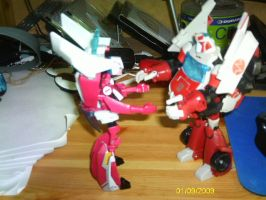 Arcee and Ratchet by Hellblaze