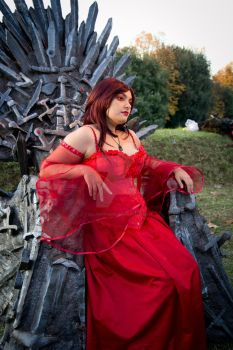 Melisandre on the Iron Throne by CalamityJade