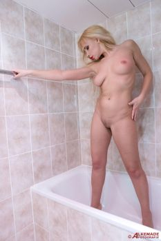 standing in the bath tub by Fotomade