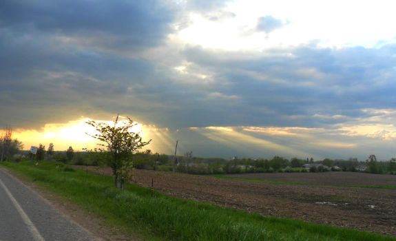 Sunshine through Strom Clouds on 20 Mile Rd by DaLeahWeathers