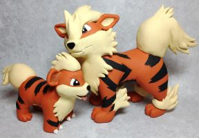 Growlithe and Arcanine Sculptures