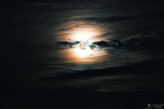 Blue Moon In Clouds by LeWelsch
