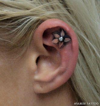 ear tattoo with piercing by Anubis-osijek
