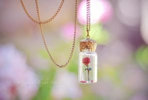 Beauty and the Beast Rose in Bottle Necklace by VintageLightJewelry