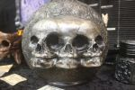 Triple Fetus skull bottle  close up. by seancfinnigan