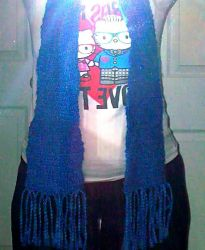 Me Wearing the first scarf I ever crochet by KellyCurly