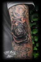 Rose on elbow tattoo by WildThingsTattoo