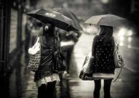 umbrellas in the rain by fbuk