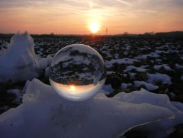 Glass sphere in a snowy landscape at dusk by Acrylicdreams