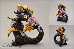 Kurokitso - the griffin with a kitty pet by CalicoGriffin
