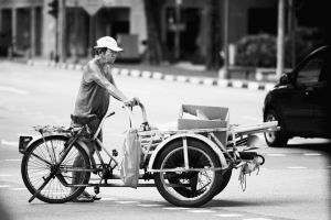 Pedaler on the Streets of Singapore by drifterManifesto