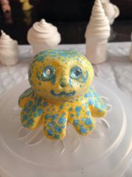 Yellow and teal octopi by Tobyana